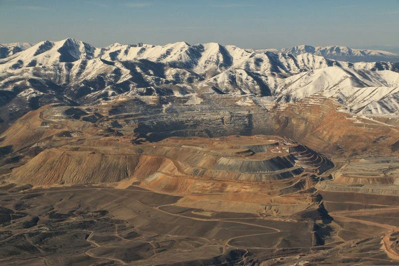 The Bingham Canyon Mine, also known as the Kennecott Copper Mine, is an open-pit mining operation extracting a large porphyry copper deposit southwest of Salt Lake City, Utah, USA, in the Oquirrh Mountains. The Bingham Canyon Mine is one of the largest open-pit mines in the world.