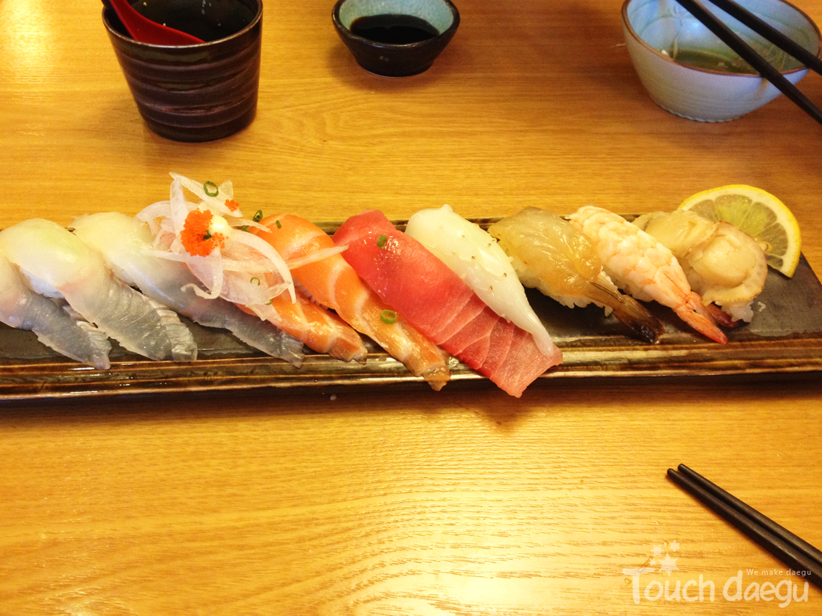 A plate filled various kinds of Sushi