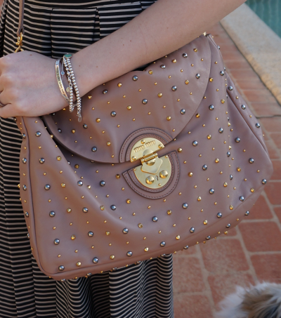 Miu Miu cammeo studded bag and bracelet stack