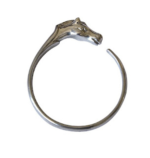 Vintage 1980's Hermes silver bangle bracelet with horse head opening.
