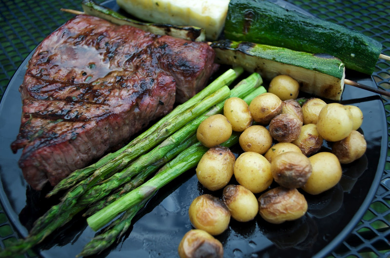 Grilled Sirloin Steak with Herb Butter, Honey Gold Potatoes, Asparagus ...