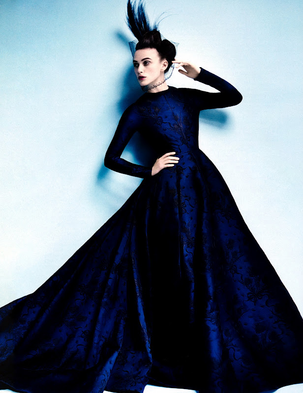 Keira Knightley posing in adark blue gown for Vogue US October 2012