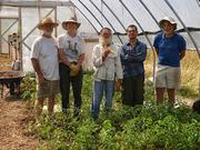 people standing in a greenhouse