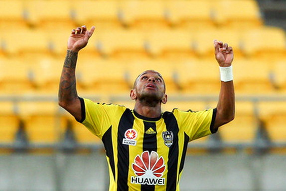Wellington Phoenix player Kenny Cunningham celebrates after scoring against Melbourne Victory