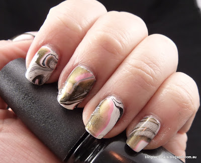 Pink, white and black water marble effect mani