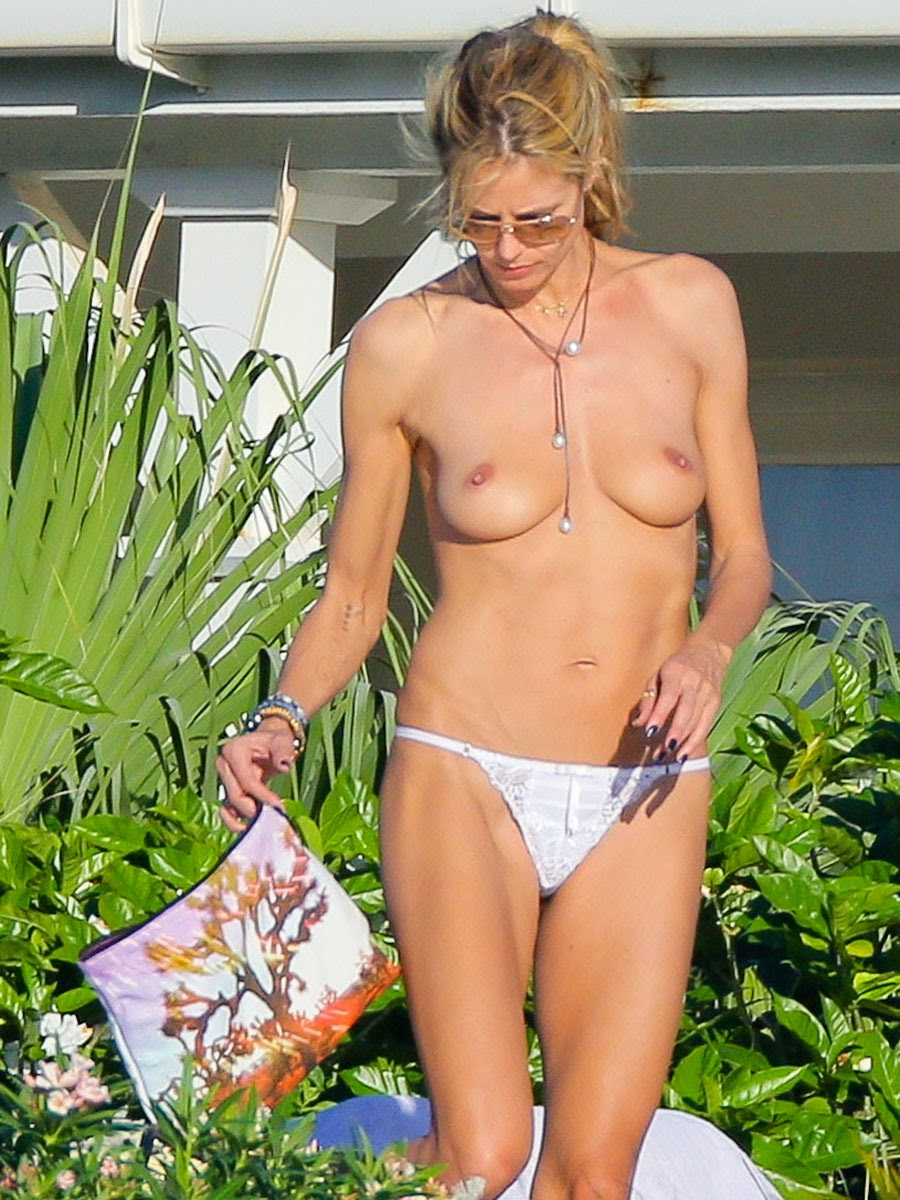 Heidi klum topless on balcony