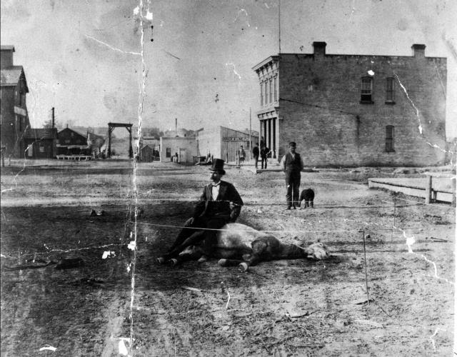"""The man, the myth, the legend…over a century later, the questions still linger: Who is the man in the picture, and what is he doing sitting on a dead horse in the middle of the intersection of Indiana and Griffith Aves. in Sheboygan, WI?"""