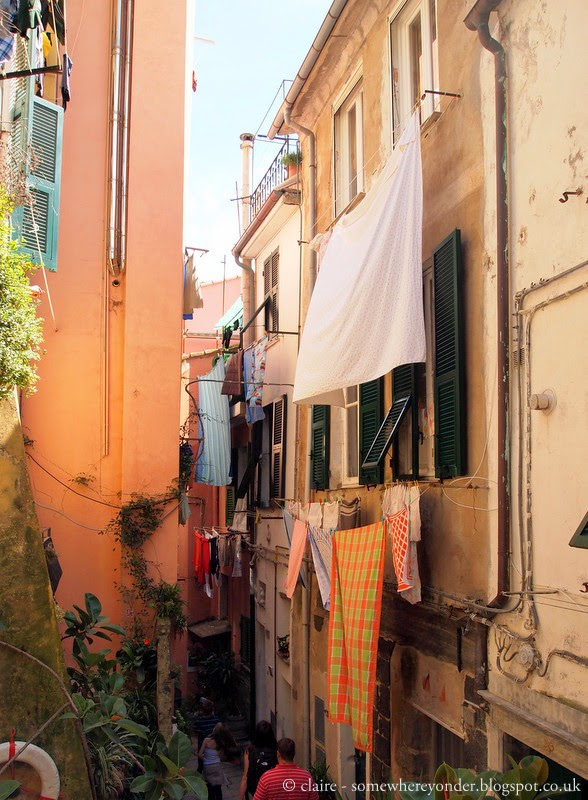 Walking down into Vernazza amoungst the coloured walls - Italy