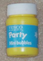 A bottle of Tesco party bubbles.