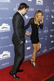 Miley Cyrus and fiance get into the position on the AIF red carpet