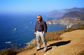 Anders standing on a bluff overlooking the California Coast Line.