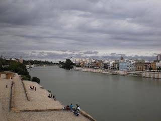 ponte isabel II, sevilla, bridge, river, people