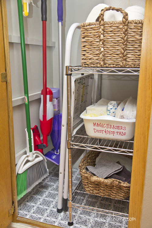 In the lower cabinet, I kept the mops, brooms, dusters and rags, and I ...