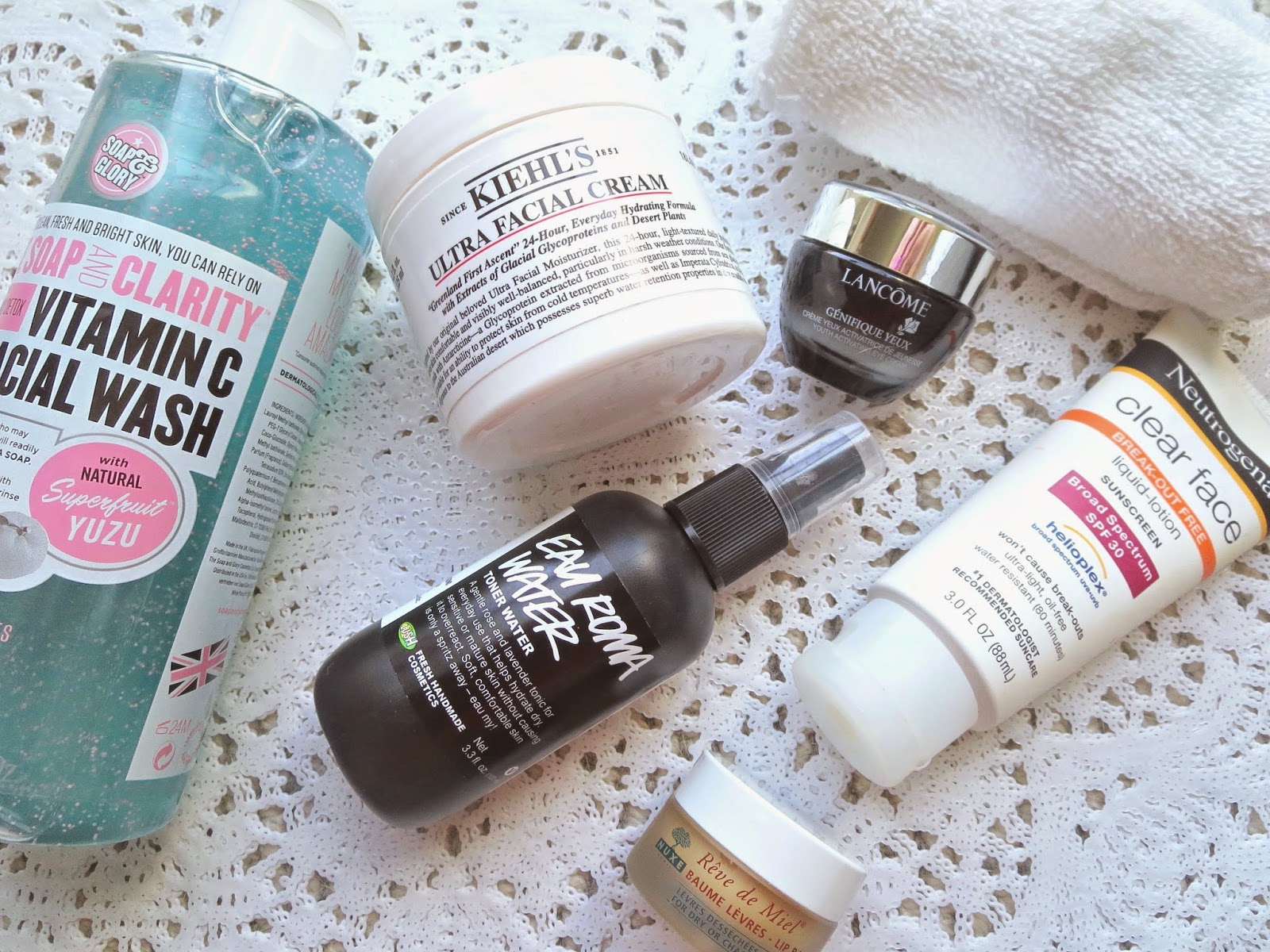 a picture of products for combination dry skin Morning Skincare Routine (Soap&Glory Vitamin C Facial wash, Kiehl's Ultra Facial Cream, Lush Eau Roma Water, Neutrogena Clear Face SPF 30, Lancome Genefique eye cream)