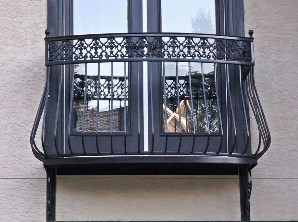 Decorative iron of nc inc wrought iron balcony design for Balcony handrail design