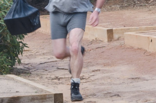 man running with underpants and boots on