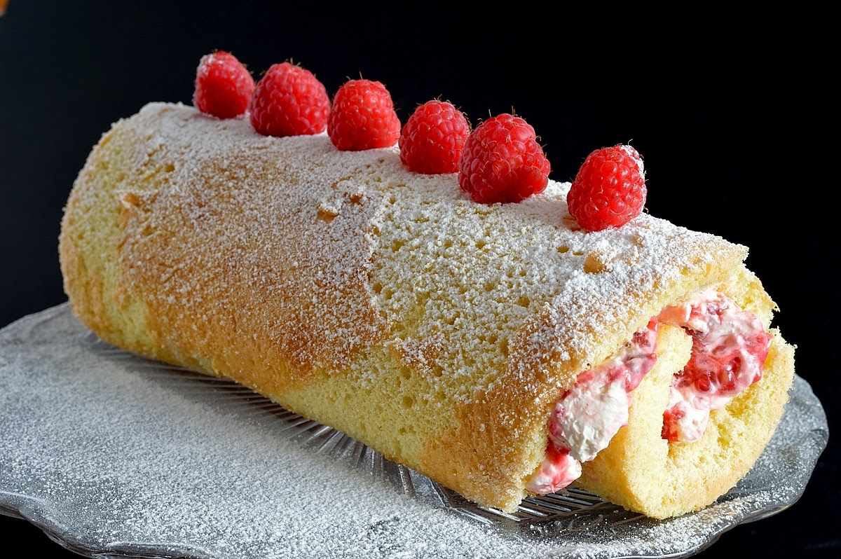 swiss roll Define swiss roll: a thin sheet of cake that is spread with jelly and rolled up.
