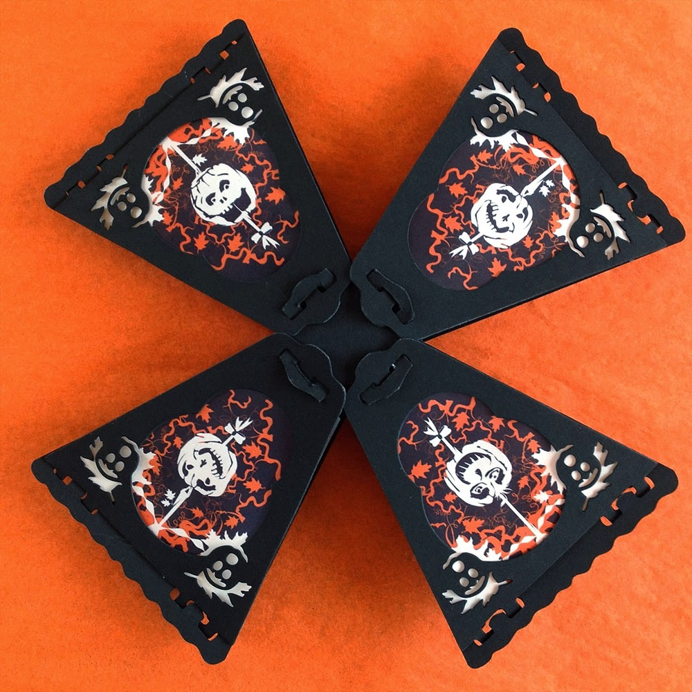 8-sided paper lanterns by Bindlegrim feature 8 Halloween pumpkins in orange and black