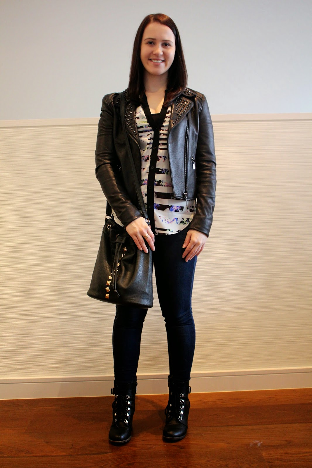 dark wash skinny jeans, sleeveless shirt, black studded leather jacket, black biker booties, black bucket bag, winter outfit, autumn outfit, fall outfit, spring outfit, everyday outfit, college outfit, uni outfit, petite girl outfit