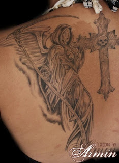 tattoo on the back: Angel of Death portrayed as a winged young woman