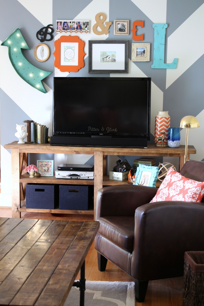 How to makeover your boring media wall using pattern, color, and eclectic decor.  Check out the gallery above the TV! www.pitterandglink.com