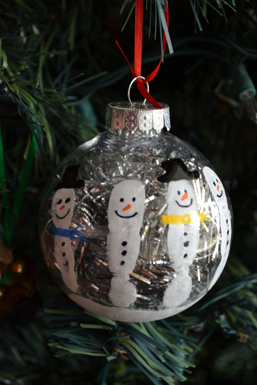Simply savvy simple handprint snowman keepsake ornament for Clear plastic craft ornaments michaels