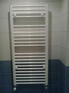 baldosassa instalar radiador toallero en el ba o