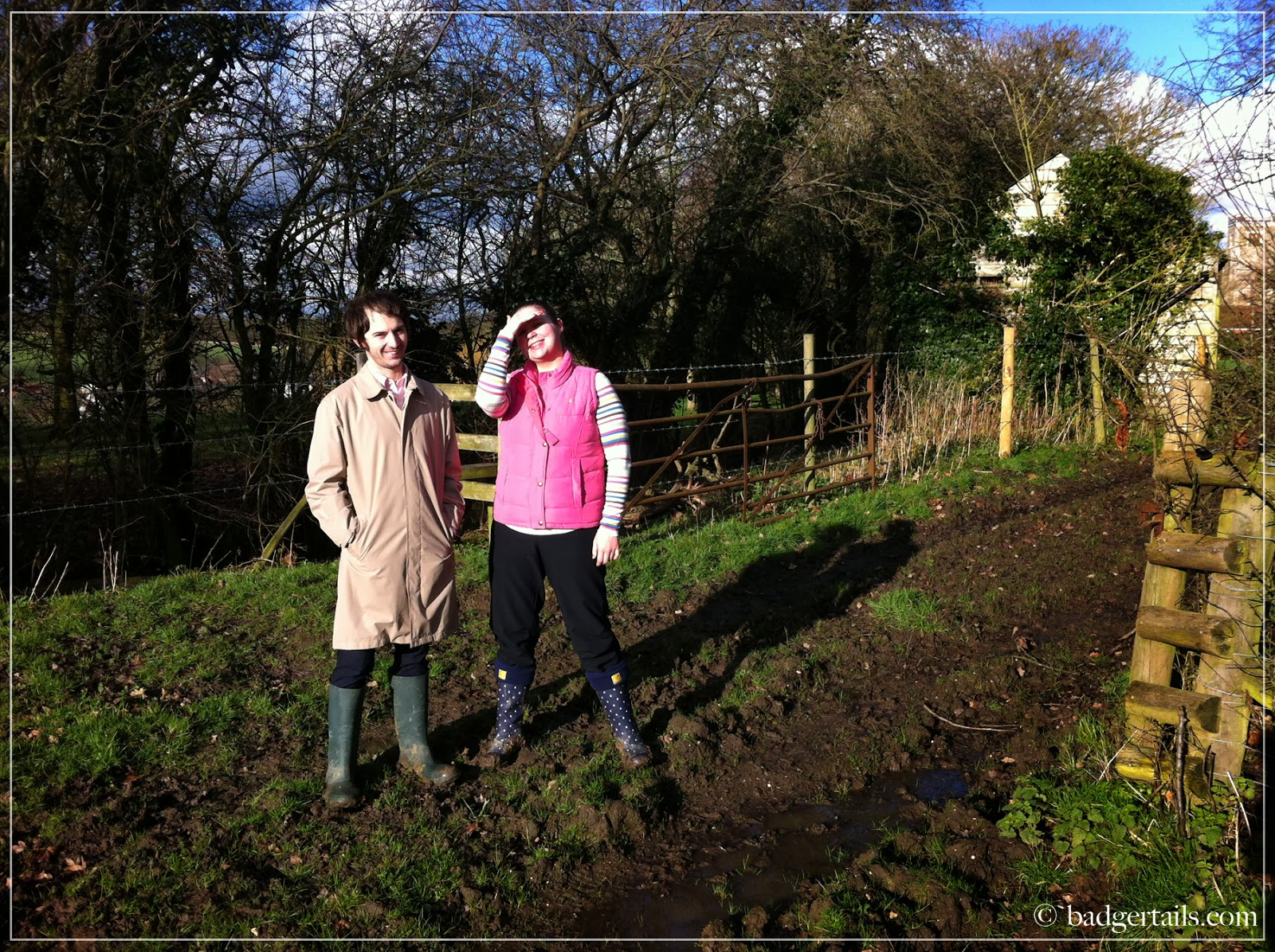 couple stood smiiling in sunny english countryside field