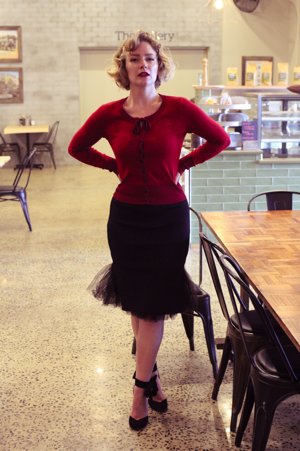 @findingfemme wears Voodoo Vixen embroidered feather cardigan with Chicwish skirt.