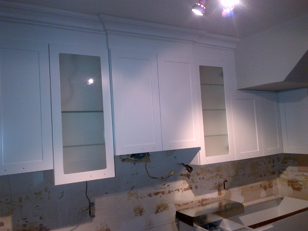 cabinets. We also had them wired for pot lights for a layer of