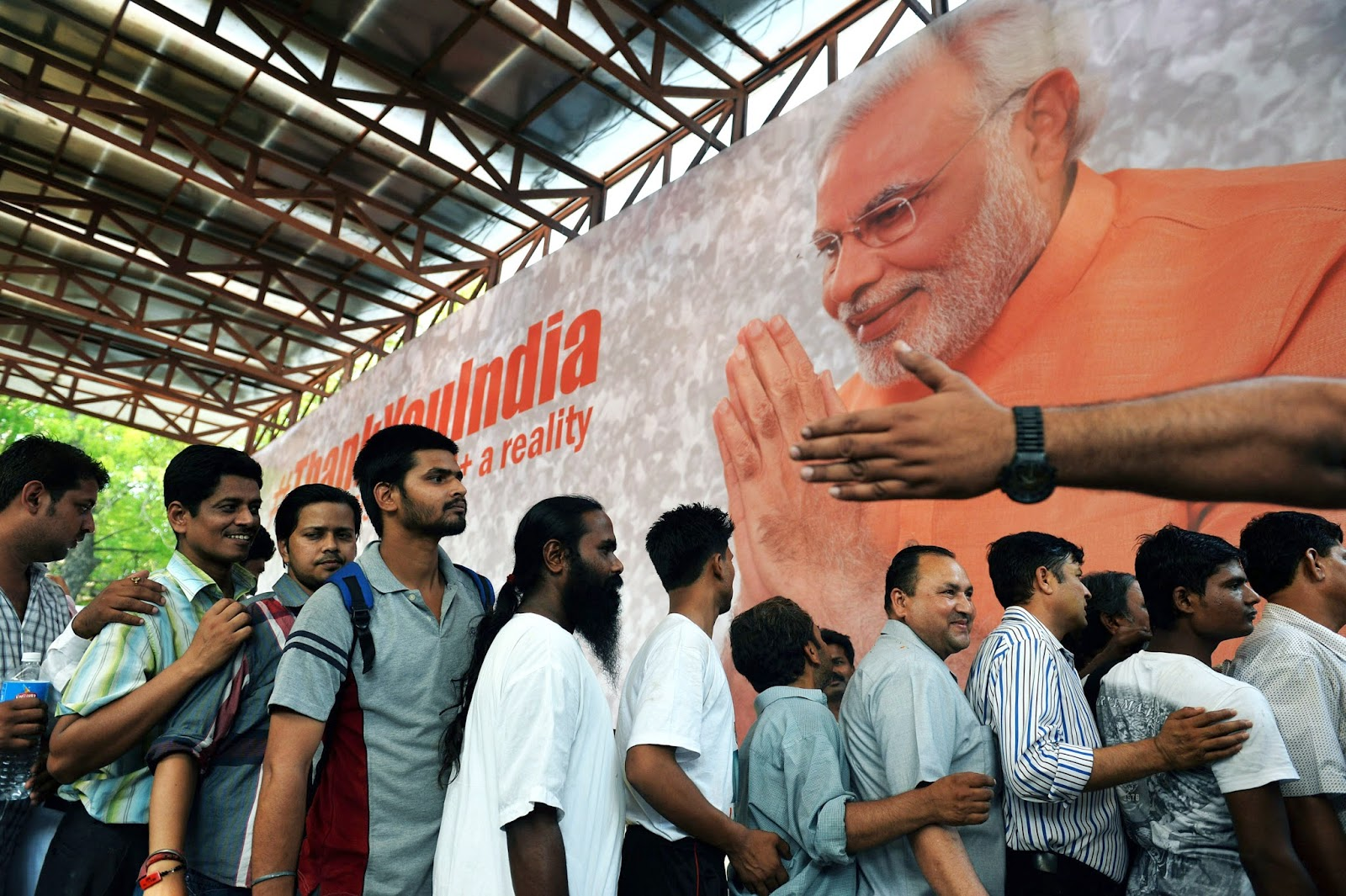 Supporters of Narendra Modi stand in line to get free t-shirts at the Bharatiya Janata Party headquarters in New Delhi on May 16, 2014. (Credit: Roberto Schmidt/AFP via Getty Images) Click to enlarge.