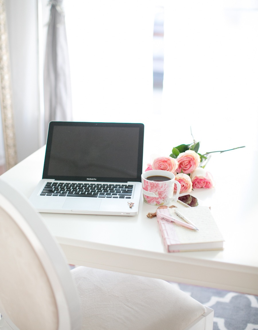 laptop with flowers and coffee