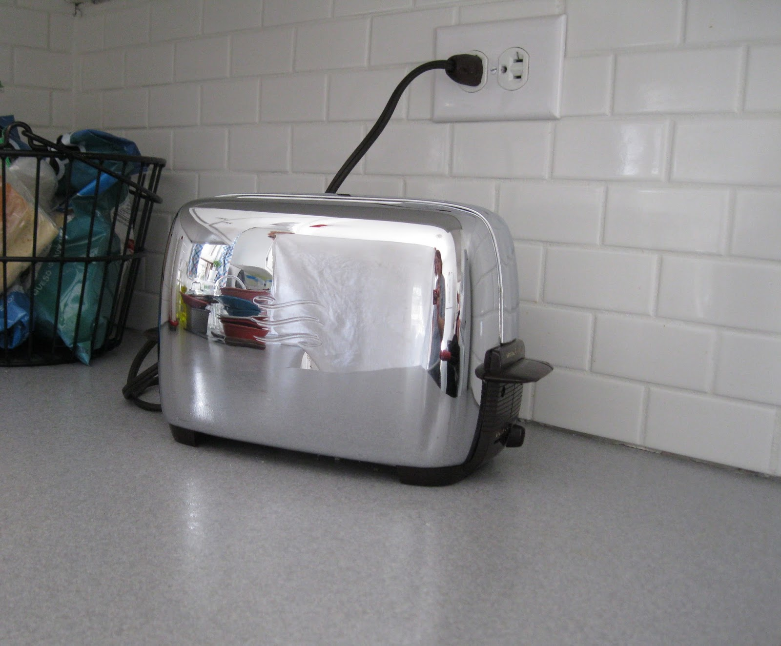 1960s Toaster With Bread ~ Apron history a shiny vintage toaster