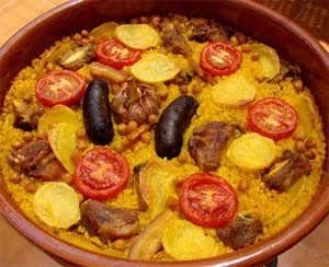 "Never confuse arroz al horno with paella, much less paella valenciana. This _other_ typical Valencian  rice dish is made with a ""cazuela"" clay pot, and _does_ have pork ribs and chickpeas in it. Paella does not."
