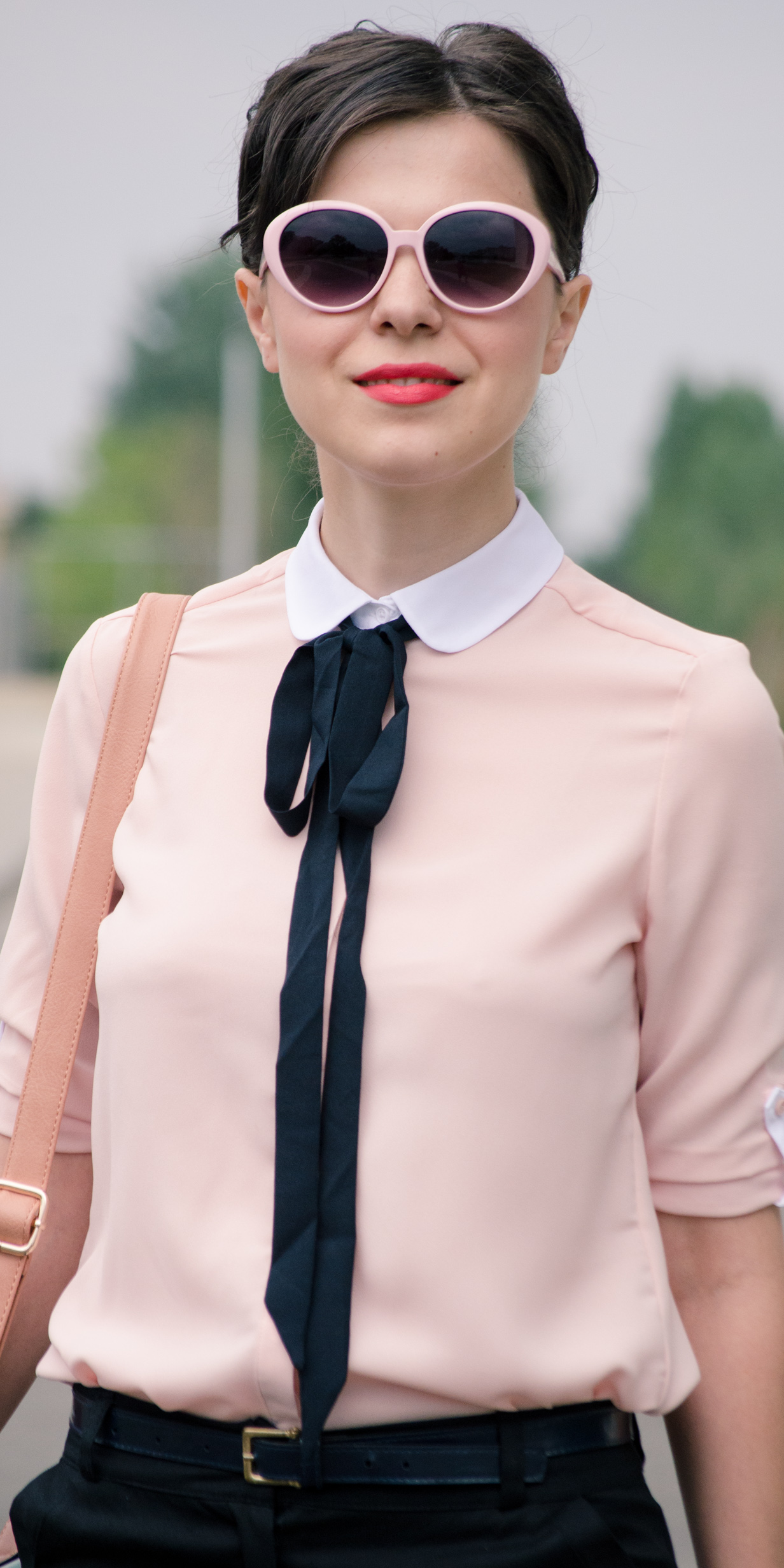 preppy back to school outfit black pants dusty pink shirt black bow pastels bag satchel nude heels