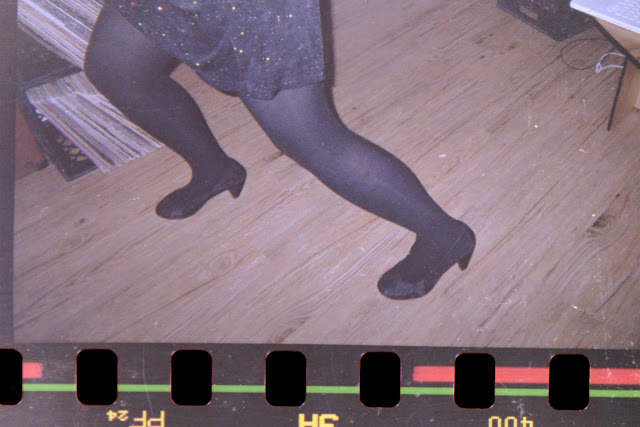 new years eve dancing, high heels, sparkles, sequings, wood floor, dance, disposable camera