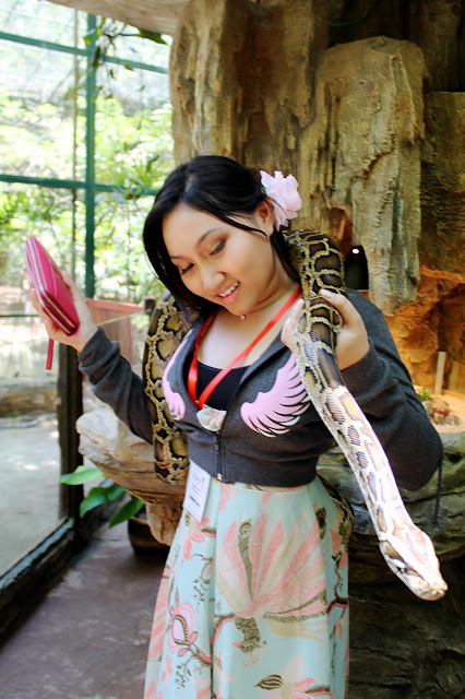 Holding a snake at the Lost World of Tambun Petting Zoo