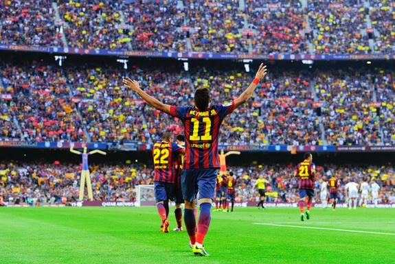 Barcelona forward Neymar celebrates after scoring the opening goal against Real Madrid