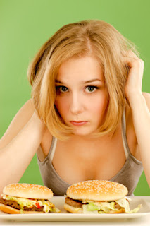 Young Woman Feels Bad About Eating Junk Food