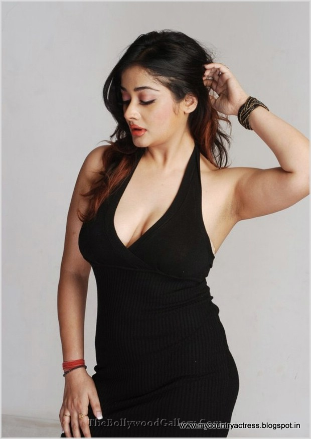 Kiran Rathod posing in a tight black mini skirt dress -  Kiran Rathod  Hot Photo Shoot