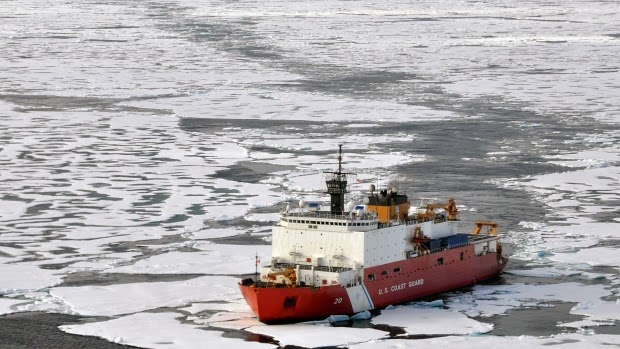 U.S. Goast Guard cutter Healy breaks ice ahead of the Canadian Coast Guard ship Louis S. St-Laurent in the Arctic Ocean. Scientists say international collaboration is an important part of their work, but is being hampered by Canadian government policies.  (Credit: Petty Officer Patrick Kelley, U.S Coast Guard/Associated Press)  Click to enlarge.