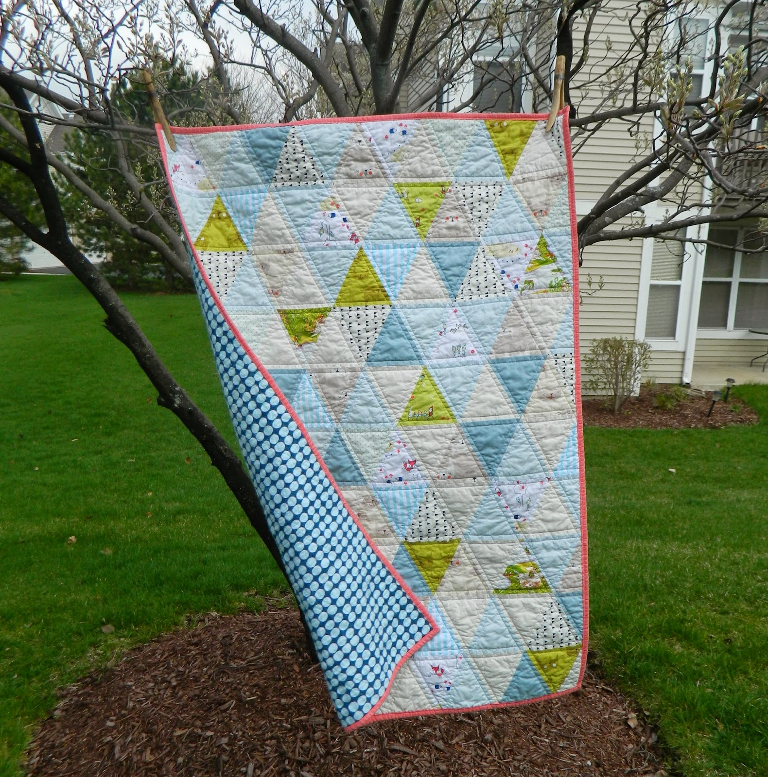 http://sotakhandmade.blogspot.com/2014/04/triangles-finished-baby-quilt.html