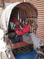 Sleeping three-wheeled bicycle taxi driver - Kathmandu