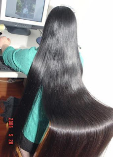 Very long and shiny black long hair Indian college girl.