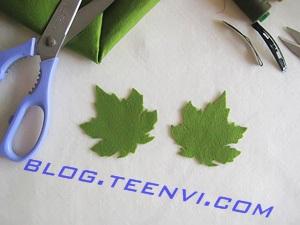 Bước 1: Dùng bút chì vẽ hình chiếc lá lên vải có kích thước phù hợp với chiếc cặp bấm.