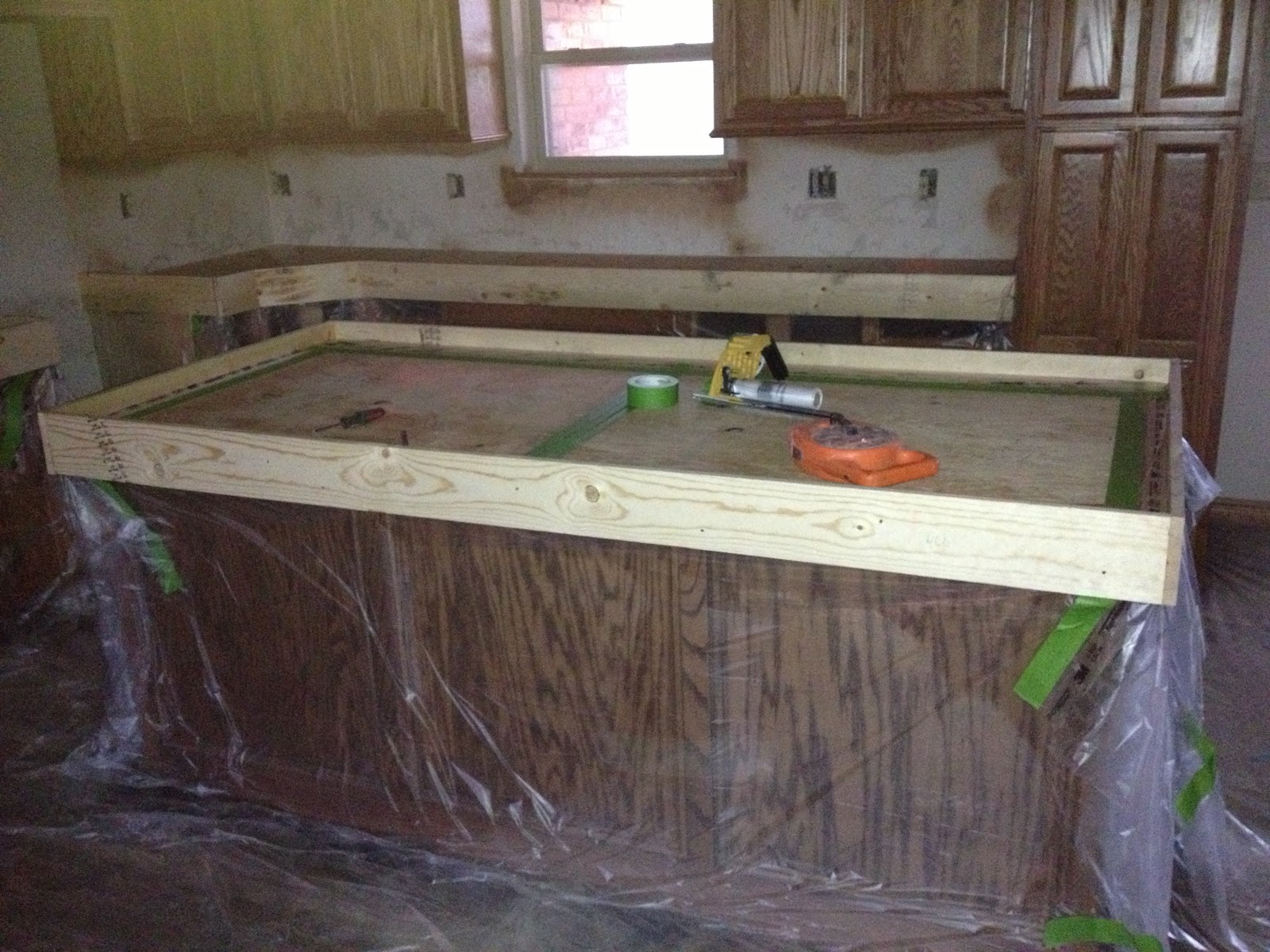 All The Cabinets Were Draped In Plastic And Taped Off, So Not To Get Any  Concrete, Stain Or Sealer On Them.