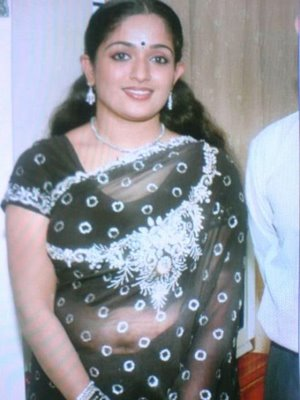Mallu Pooru Mula Check Kavya Madhavan And Mulakal Kundi Wallpaper With