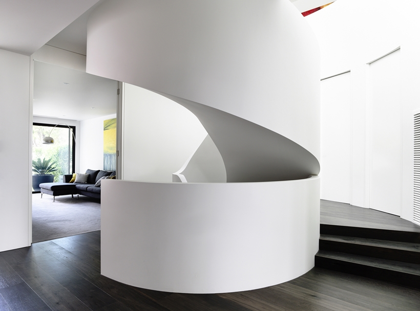 Minimalist spiral stairs in Perfect Modern Townhouse by Martin Friedrich Architects