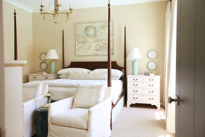 coastal modern romantic bedroom with white slipcover chairs