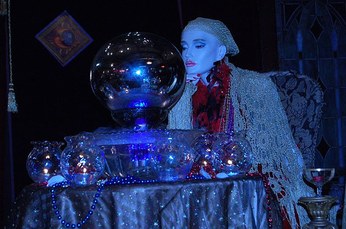 Photo of a psychic looking into a crystal ball
